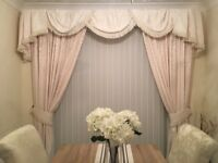 Cream lined curtains with tie backs, swags & tails.