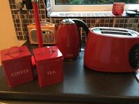 Kettle, toaster, tea & coffee canisters & kitchen roll holder . Red