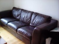 large dark brown leather sofa