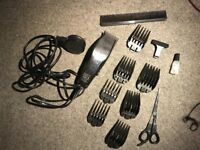 WAHL Hair Clippers with 8 adapters, scissors, comb and oil
