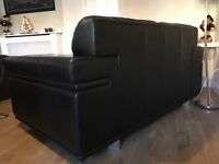 Two seater leather sofa and footstool