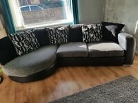 Large corner sofa and large swivel chair in grey/black