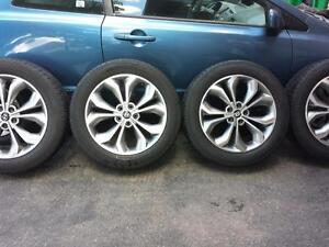 HYUNDAI SANTA FE 2013 FACTORY OEM 19 INCH WHEELS WITH HIGH PERFORMANCE CONTINENTAL 235 / 55 / 19 ALL SEASON TIRES.