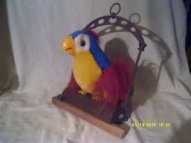 THE PARROT THAT ANSWERS YOU BACK , BATTERY OPERATED TALKING PARROT ? ? ? ? +++++++++++