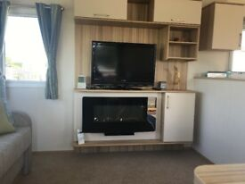 Superb 2017 static caravan complete with decking on Talacre 5* holiday park.
