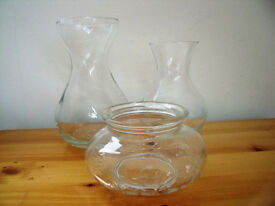 A collection of 3 clear glass items: 2 x vases & 1 x container. £1.50 the lot