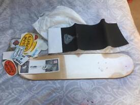 Skateboard pack deck, grit and lots of stickers