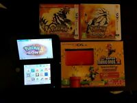 Red 3ds xl with pokemon sun, omega ruby and super Mario bros 2