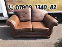2 seater sofa in a brown leather with curved arms £85
