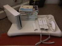 Wii, wii sports board, 8 games, 2 remotes and nunchuck
