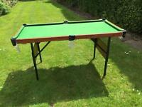 Folding pool table and accessories
