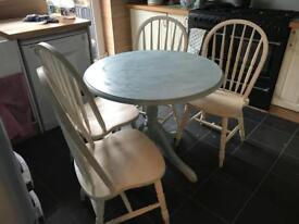 Painted round pine table and four chairs. Could do with another coat of paint.