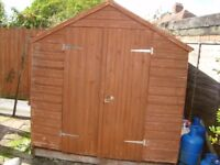 7FT X 7FT DOUBLE DOOR GARDEN SHED WITH BASE WILL NEED A NEW ROOF BUYER DISMANTLES AND TAKES AWAY