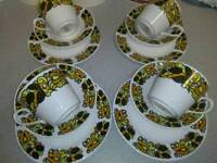 VINTAGE 12 PC TEA SET, FROM THE 1970'S , WHITE PORCELAIN BACKGROUND, WITH RETRO COLOURS