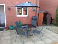 4 seater patio set complete with umbrella