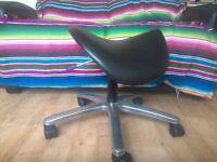 Therapist saddle stool on castor wheels