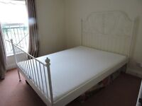 Double bed & mattress practically new