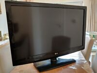 LG 42 inch TV, TV stand, DVD and surround sound system