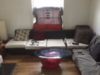 Selling black and white 4 seater sofa (and bed) which can be modelled in L shape or strait line