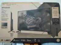 Polaroid 42 inch full hd tv hardly used with warranty
