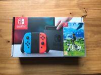 Nintendo Switch - Neon Red & Neon Blue + Zelda Breath of the Wild game
