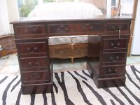 Chesterfield Desk with 8 drawers, some lockable, green leather desk top, good condition, space short