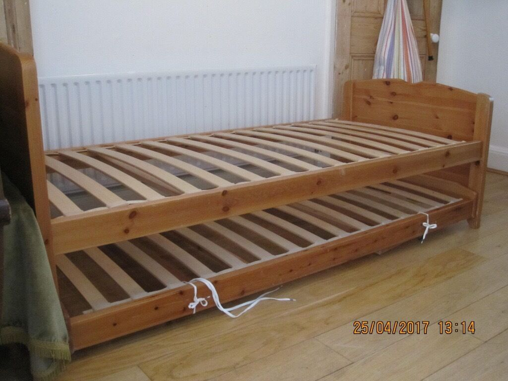solid wood single bed with matching trundle bed, converts to twin