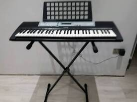 Yamaha digital keyboard and key board stand