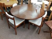 Round Dark Wood Dining Table + 4 Cream Cushioned Chairs