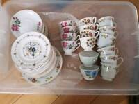 Assorted tea cups, saucers and side plates
