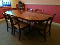 Twin pedestal extending dining table and eight chairs for sale