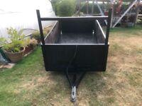 Box trailer with ladder bar