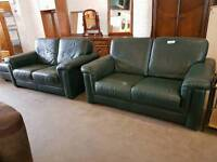 Modern green leather twin two seater sofa suite with pouffe