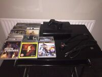 SONY Super slim Playstation 3 - Great condition with games