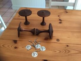Two pairs of decorative wooden curtain holders with all the fittings
