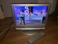 """M&S 15"""" LCD TV boxed with a built in DVD player and free view with remote control"""