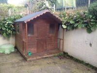 Children's play house for sale - wonderful fun house complete with four windows and verandah