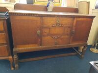 Beautiful Vintage solid oak sideboard with stretcher base