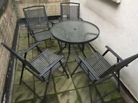 Garden table with four foldable chairs