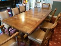 Solid oak dining table (extending) with 8 chairs