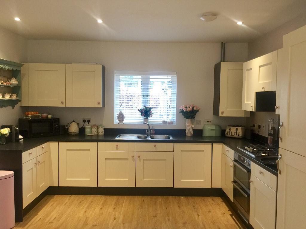 Paula Rosa Cream Kitchen Units Cupboards Black Worktop
