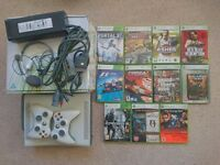 Mint condition Xbox 360 60GB in original box with 12 games and 2 controllers