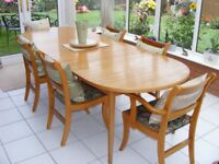 Teak dining table with 4 chairs and 2 carvers.