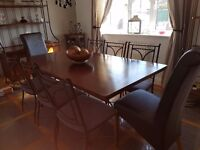 Beautiful solid wood and wrought iron table and 8 chairs