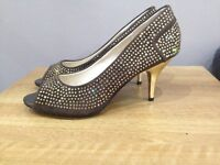 Two toned diamante studded shoes with gold heels