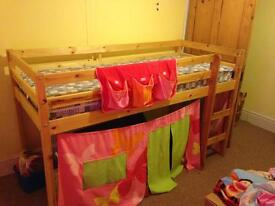 Single wooden cabin bed with play area