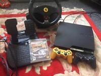 Slim PS3(excellent condition) with 2 joysticks and racing steering wheel and pedals.