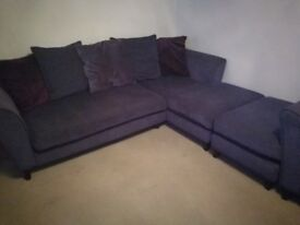 Sofa with chaise long, chair and pouffe. Purple