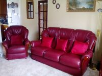 Burgundy Italian Leather 3 piece suite. Has some scratches, but in good overall condition.