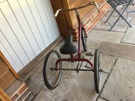 Child's vintage tricycle in need of some TLC